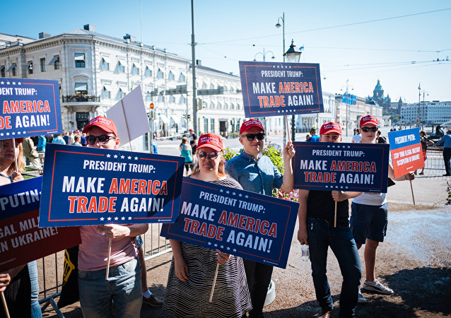 Trump supporters hold banners during a demonstration at the Esplanadi park in Helsinki, Finland, on July 16, 2018, hours ahead of the meeting between US President and his Russian counterpart