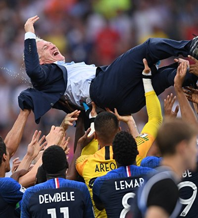 France's players and their head coach Didier Deschamps celebrate team's 4-2 victory in the World Cup final soccer match between France and Croatia at the Luzhniki stadium, in Moscow, Russia, July 15, 2018.