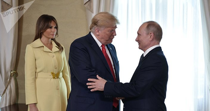 Russia's President Vladimir Putin (R) greets U.S. President Donald Trump, as First lady Melania Trump stands nearby, during a meeting in Helsinki, Finland July 16, 2018