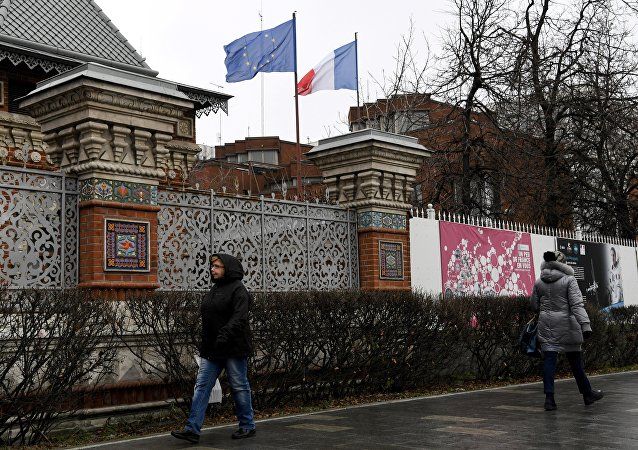 (File) People walk past the French embassy in Moscow on November 10, 2017