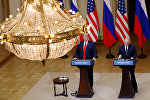 U.S. President Donald Trump and Russian President Vladimir Putin hold a joint news conference after their meeting in Helsinki, Finland, July 16, 2018