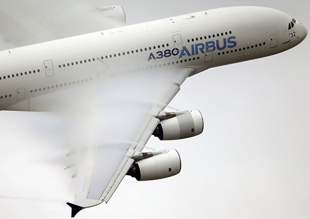 In this June 18 2015 file photo, vapour forms across the wings of an Airbus A380 as it performs a demonstration flight at the Paris Air Show, Le Bourget airport, north of Paris
