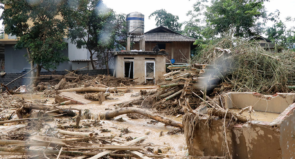 A general view shows debris in a village damaged by flash flooding in Vietnam's Yen Bai province on July 21, 2018