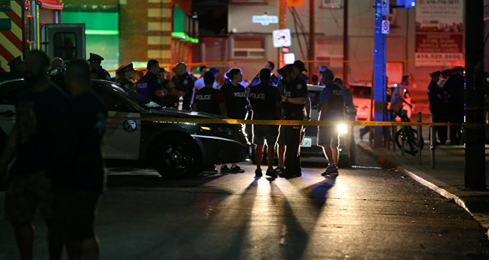 Police are seen near the scene of a mass shooting in Toronto, Canada, July 22, 2018