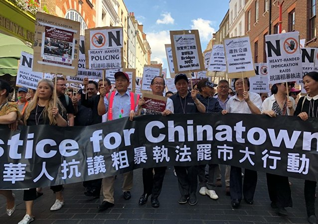 Residents of Chinatown protest in London, UK