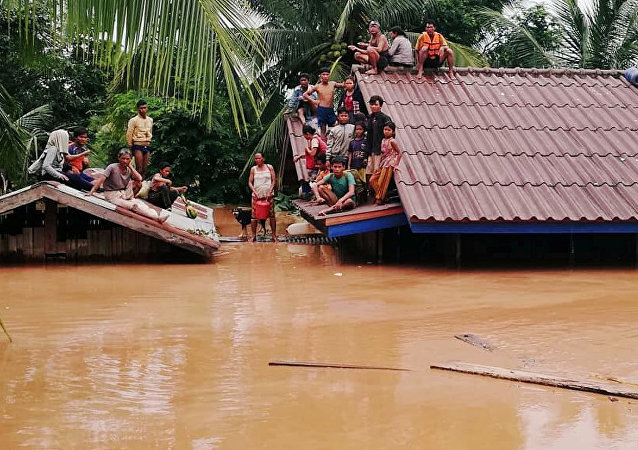 Villagers evacuate after the Xepian-Xe Nam Noy hydropower dam collapsed in Attapeu province, Laos July 24, 2018