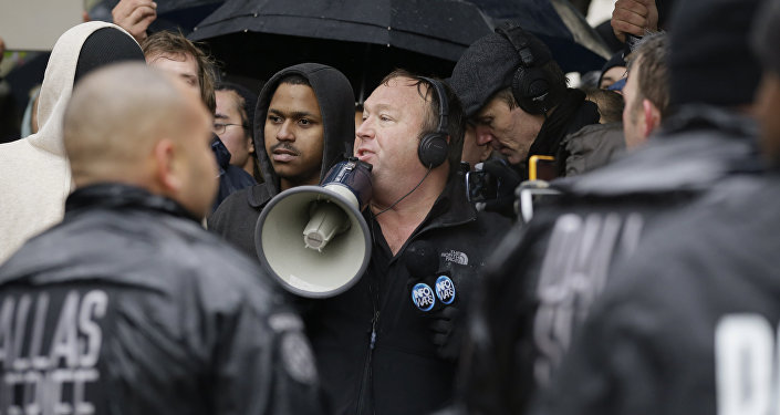 Talk show host Alex Jones (C) leads a protest after a ceremony to mark the 50th anniversary of the assassination of John F. Kennedy, Friday, Nov. 22, 2013, at Dealey Plaza in Dallas