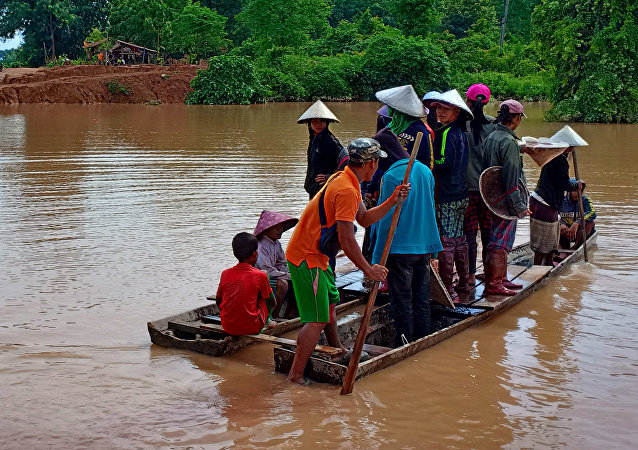 Villagers are evacuated after the Xepian-Xe Nam Noy hydropower dam collapsed in Attapeu province, Laos July 24, 2018