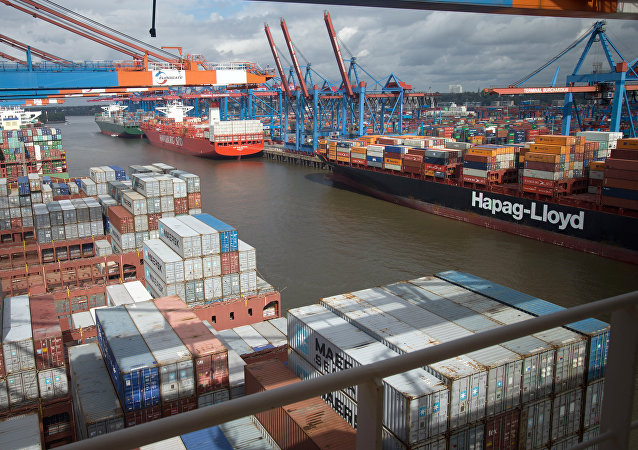 (File) Containers are loaded onto a ship at the container terminal Eurogate at the port of Hamburg, northern Germany on August 25, 2014