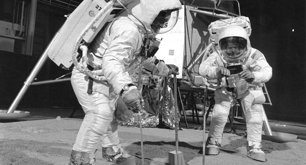 Two members of the Apollo 11 lunar landing mission participate in a simulation of deploying and using lunar tools on the surface of the Moon during a training exercise on April 22, 1969