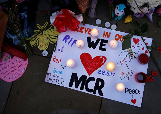 Flowers and messages are left for the victims of the Manchester Arena attack in central Manchester, Britain May 23, 2017.