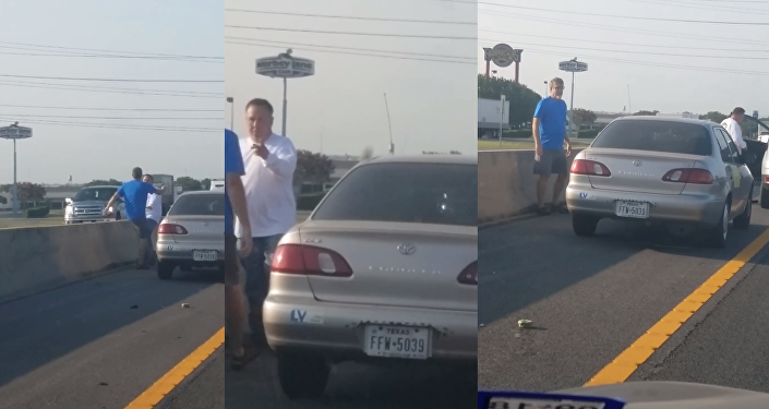 Man clings to hood of speeding SUV during road rage incident