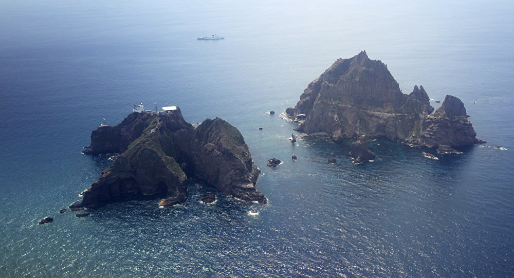 Islands called Dokdo in Korea and Takeshima in Japan are seen Friday, Aug. 10, 2012