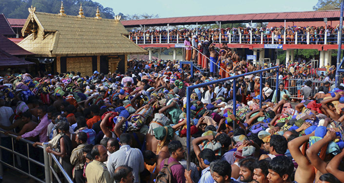 In this Dec. 1, 2015 photo, Hindu worshippers queue during a pilgrimage at the Sabarimala temple in the southern Indian state of Kerala