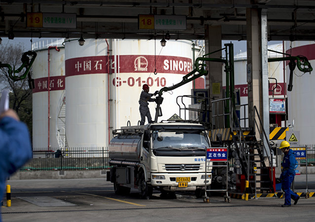 This picture taken on March 22, 2018 shows a man working in a filling station of Sinopec, China Petroleum and Chemical Corporation, in Shanghai