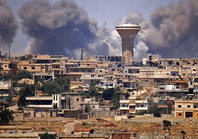 Smoke rises above rebel-held areas of the city of Daraa during reported airstrikes by Syrian regime forces on July 5, 2018
