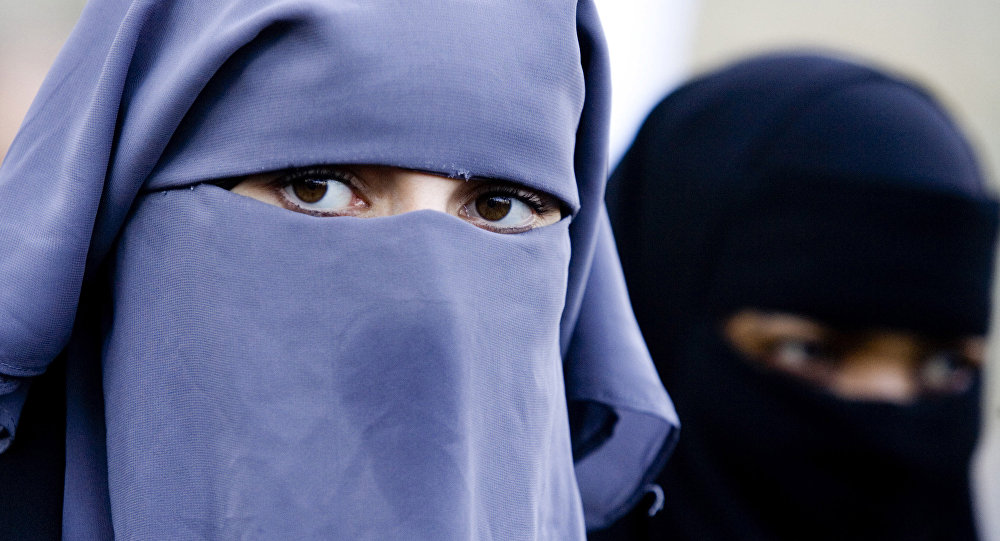 Unidentified women are seen wearing a niqab
