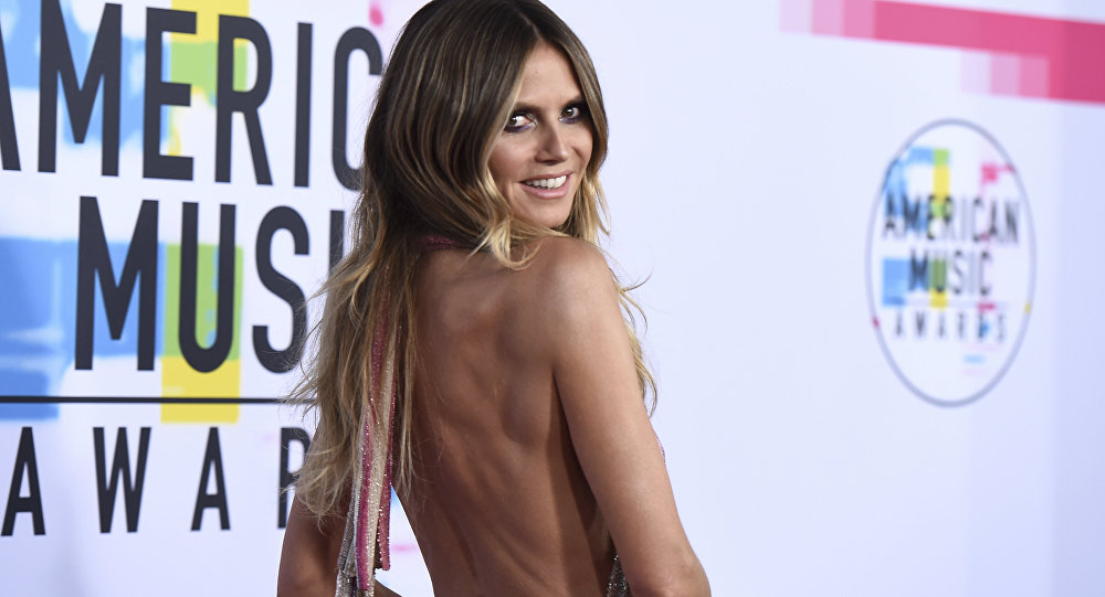 Heidi Klum arrives at the American Music Awards at the Microsoft Theater on Sunday, Nov. 19, 2017, in Los Angeles.