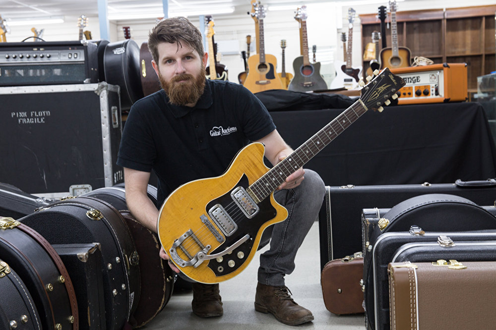 Gardiner Houlgate expert and auctioneer Luke Hobbs holds the Maton
