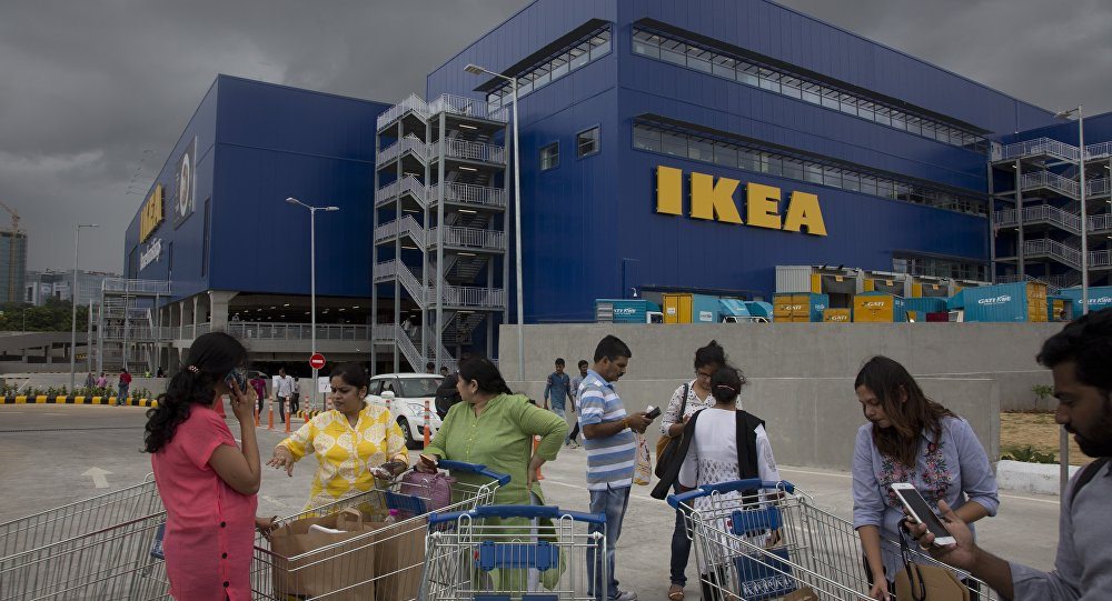 Indian customers stand outside IKEA's first store in India as it opened in Hyderabad, India, Thursday, Aug.9, 2018