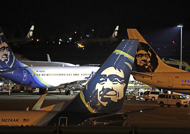 Alaska Airlines planes sit on the tarmac at Sea-Tac International Airport Friday evening, Aug. 10, 2018, in SeaTac, Washington