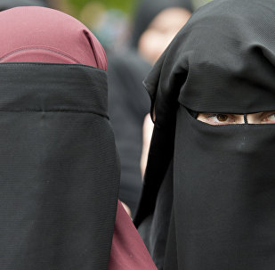 In this June 28, 2014 file photo veiled women attend a speech by preacher Pierre Vogel, in Offenbach, near Frankfurt, Germany. A law that forbids any kind of full-face covering, including Islamic veils such as the niqab or burqa, has come into force in Austria Sunday, Oct. 1, 2017. Only a small number of Muslim women in Austria wear full-face veils, but they have become a target for right-wing groups and political parties. France and Belgium have similar laws and the nationalist Alternative for Germany party is calling for a burqa ban there too
