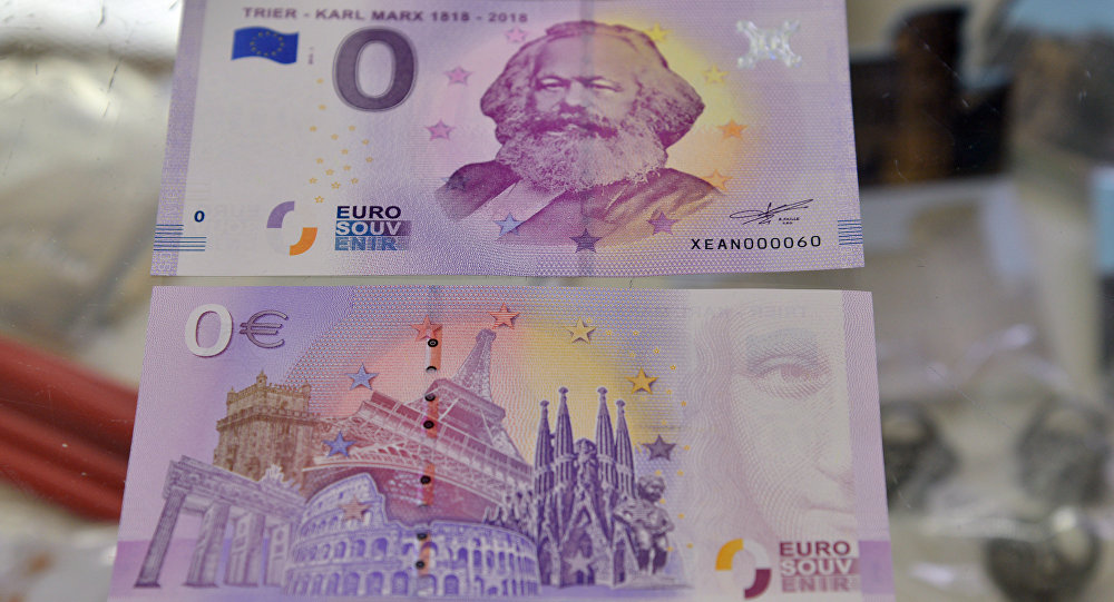 This picture taken on April, 10, 2018 in Trier, southwestern Germany, shows the front and the back side of a Zero-Euro-bank note realeased on the occasion of German philosopher Karl Marx's bicentenary