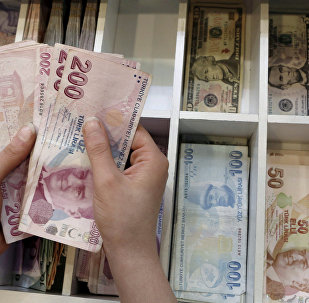 A money changer counts Turkish lira bills at an currency exchange office in central Istanbul, Turkey.