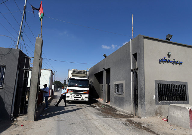 A truck carrying food products arrives at Kerem Shalom crossing in Rafah in the southern Gaza Strip July 10, 2018