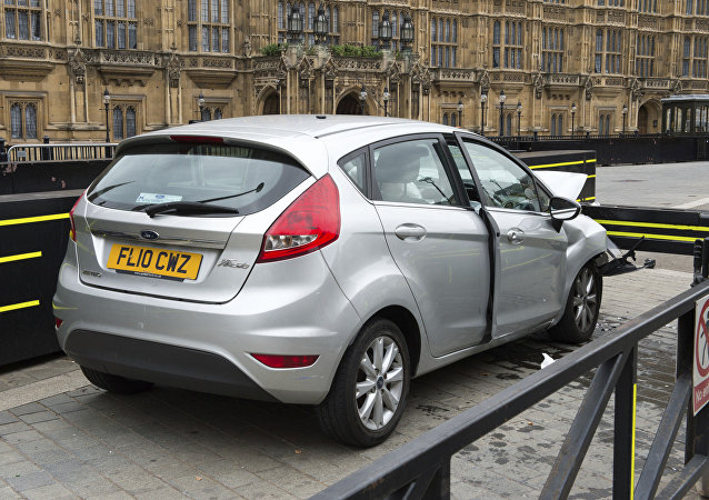The car that was driven at pedestrians and cyclists in Westminster then crashed into the barrier outside the Houses of Parliament on Tuesday is seen in an image handed out by the Metropolitan Police in London, August 15, 2018