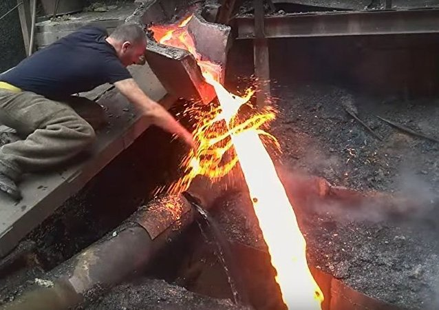 Steel Mill Worker Manhandles Molten Metal
