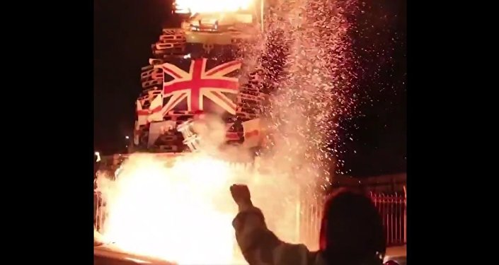 Union Jacks and Ulster Banners burn in Bogside bonfire