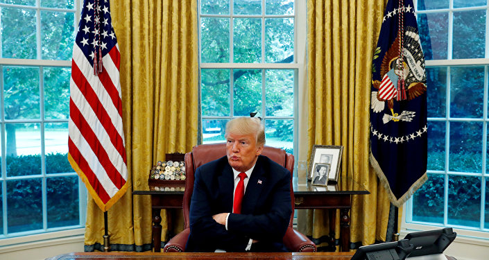 US President Donald Trump reacts to a question during an interview with Reuters in the Oval Office of the White House in Washington, August 20, 2018