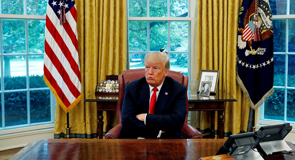 US President Donald Trump reacts to a question during an interview with Reuters in the Oval Office of the White House in Washington, U.S. August 20, 2018