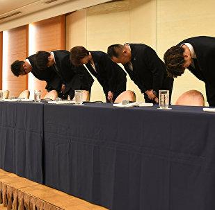 L-R: Japan's basketball players, Yuya Nagayoshi, Takuya Hashimoto, head of the Japan Basketball Association Yuko Mitsuya, technical chairperson Tomoya Higashino, Takuma Sato, Keita Imamura, bow at the beginning of a press conference in Tokyo on August 20, 2018