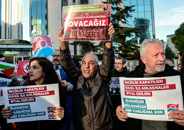 Leftist protesters chant slogans against the US and Israel as they hold placards reading US airbase in Incirlik should close - Cut all relations with Israel- USA get out of our country and the Middle East on December 9, 2017