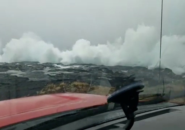 Waves crash on the coast as Hurricane Lane approaches Ka'u, Hawaii, U.S. August 22 2018, in this still image obtained from a social media video. Video taken from inside a vehicle. Courtesy of Ken Boyer