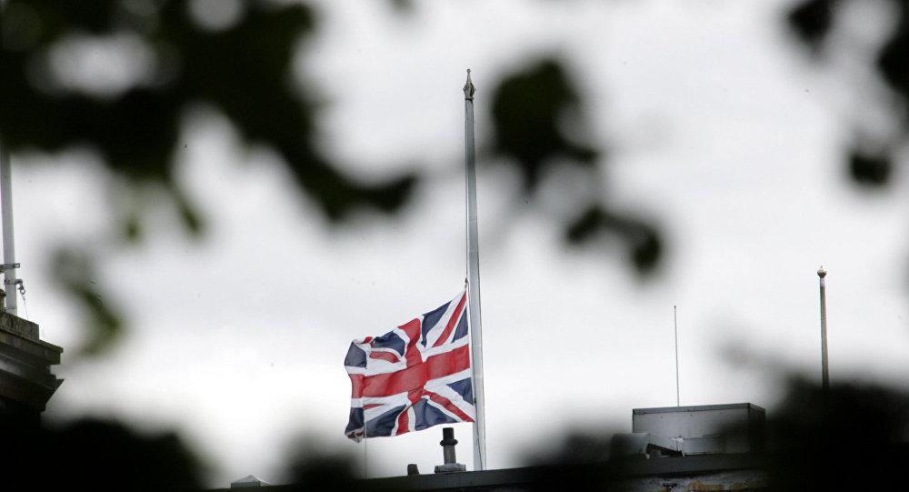 The British flag is seen at half mast.
