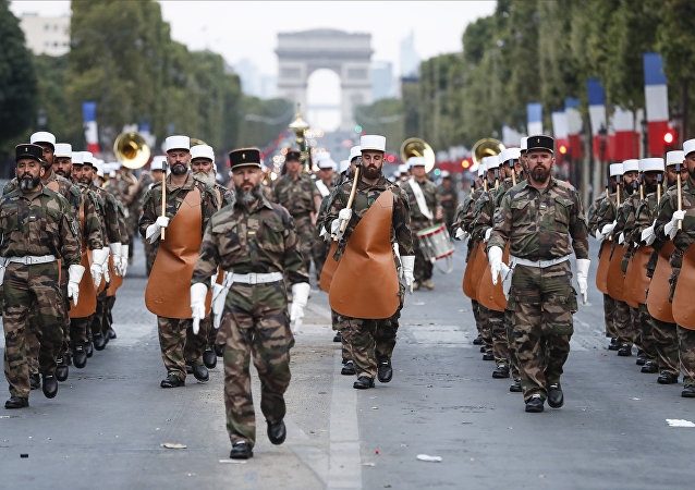 Soldiers of the French Foreign Legion parade on the Champs Elysees avenue during a rehearsal for Bastille Day, early Wednesday, July 11, 2018 in Paris