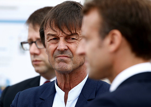 Nicolas Hulot, French Minister for the Ecological and Inclusive Transition looks over towards French President Emmanuel Macron as they visit the Cap Frehel peninsula in northern Brittany, France, June 20, 2018
