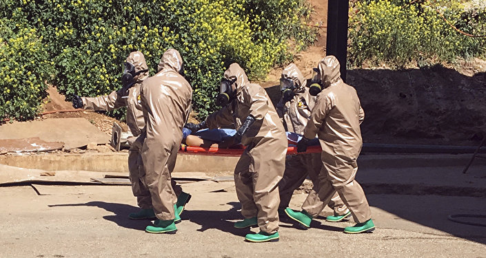 April 4, 2017 and made available Wednesday, April 5, Turkish experts carry a victim of alleged chemical weapons attacks in Syrian city of Idlib, at a local hospital in Reyhanli, Hatay, Turkey