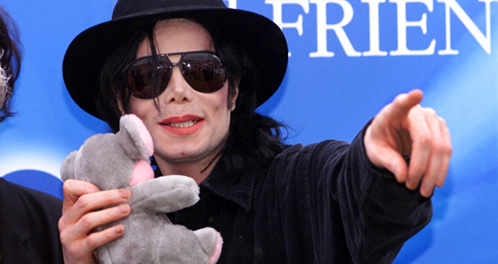 Famous pop singer Michael Jackson points to some hundred fans during a press conference at Munich's Olympic stadium Wednesday, June 9, 1999. Jackson visited the Bavarian capital to promote his charity concert Michael Jackson and Friends on June 27, 1999