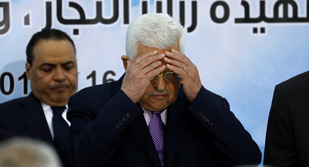 Palestinian President Mahmoud Abbas prays at the opening of the Palestinian Central Council meeting, in Ramallah, in the occupied West Bank August 15, 2018