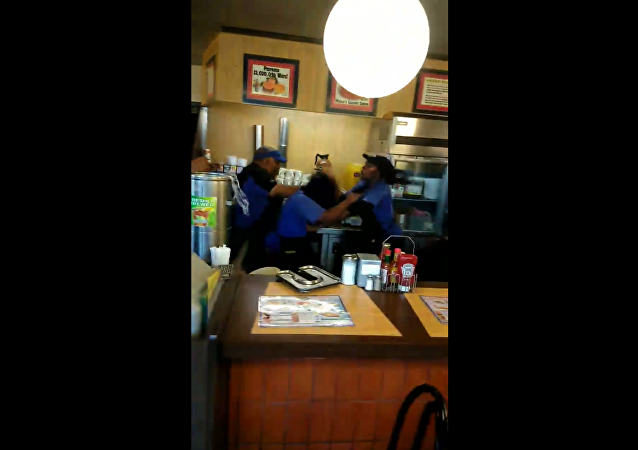 Waffle House employees in Memphis, Tennessee, get into a violent brawl over washing dishes