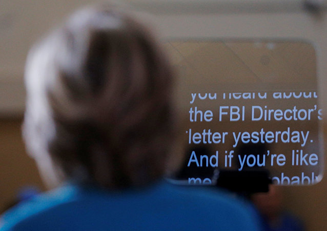 Hillary Clinton speaks about the FBI inquiry into her emails during a campaign rally in Daytona Beach, Florida