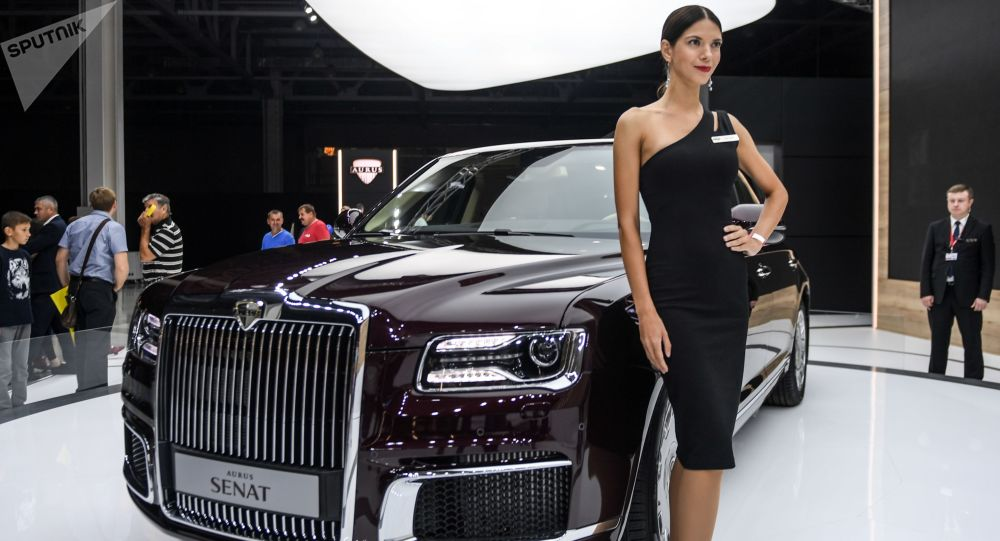 A model poses at the Aurus company stand during the 2018 Moscow International Auto Show.