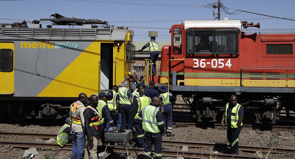 The scene of an early morning train collision in a suburb of Johannesburg Tuesday, Sept. 4, 2018