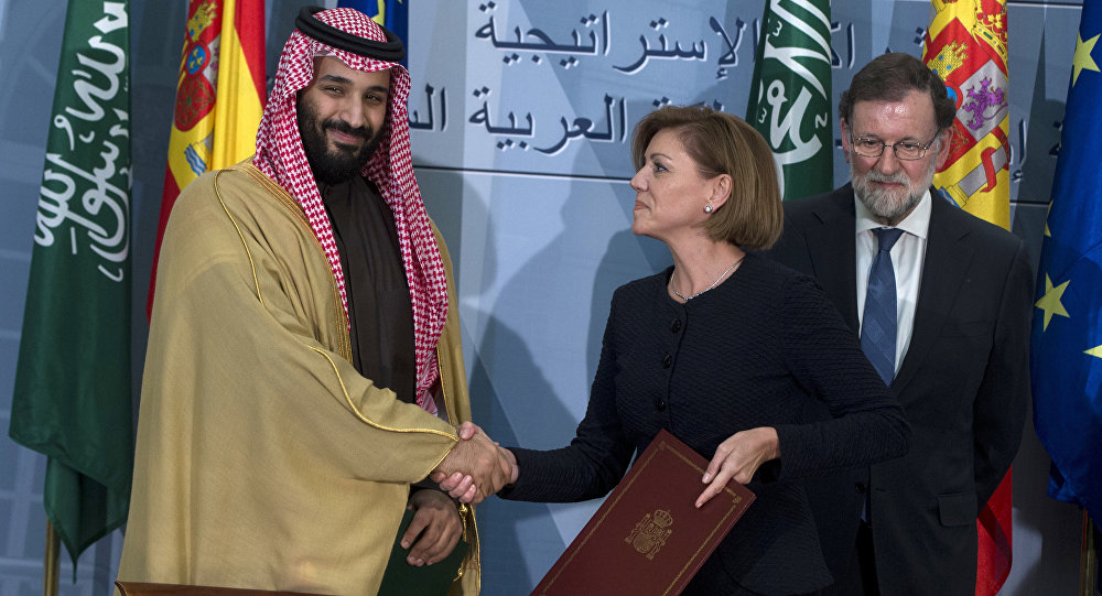 FILE - In this April 12, 2018 file photo, Saudi Arabia Crown Prince Mohammed bin Salman, left and Spain's then Defense Minister Maria Dolores Cospedal shake hands after signing bi-lateral agreements in the presence of the then Prime Minister of Spain Mariano Rajoy, right, at the Moncloa Palace in Madrid, Spain. Spain has cancelled the sale of 400 laser-guided bombs to Saudi Arabia it was reported Tuesday Sept. 4, 2018, amid fears that the weapons could be used in the Riyadh-led coalition fighting the Iran-aligned Houthi rebels in Yemen