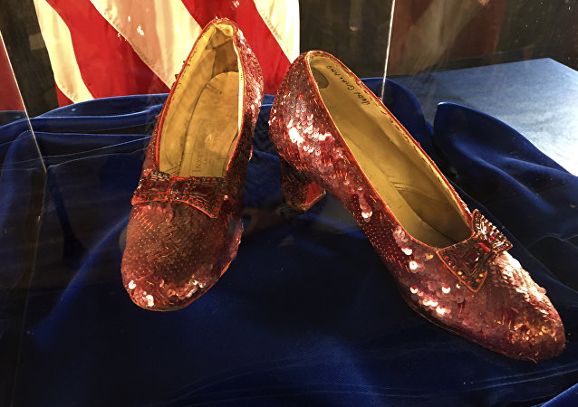 A pair of ruby slippers once worn by actress Judy Garland in the The Wizard of Oz are displayed at a news conference Tuesday, Sept. 4, 2018, at the FBI office in Brooklyn Center, Minn
