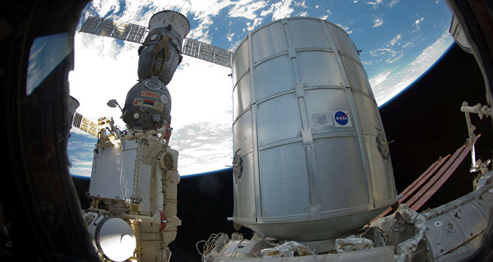 Permanent Multipurpose Module (PMM) and a docked Russian Soyuz spacecraft